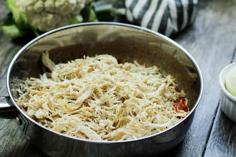 Shredded chicken in a pan.