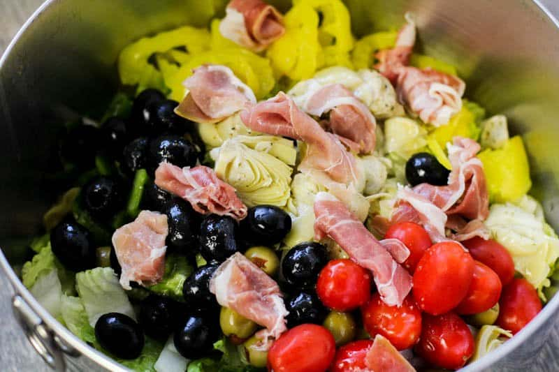 Low Carb Antipasto Salad Recipe with prosciutto in a metal mixing bowl