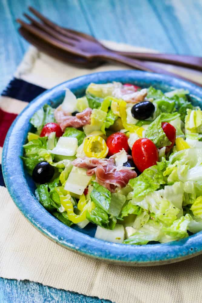 Low Carb Antipasto Salad in a teal plate