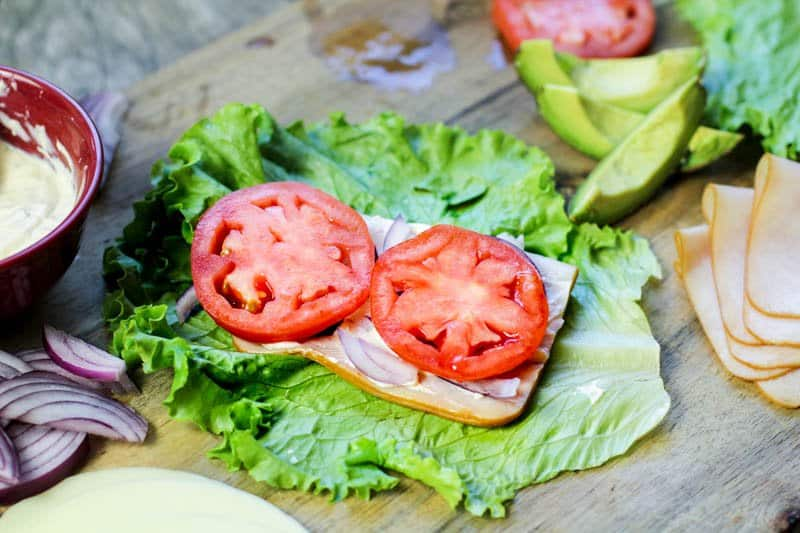 tomato slices on a lettuce wrap