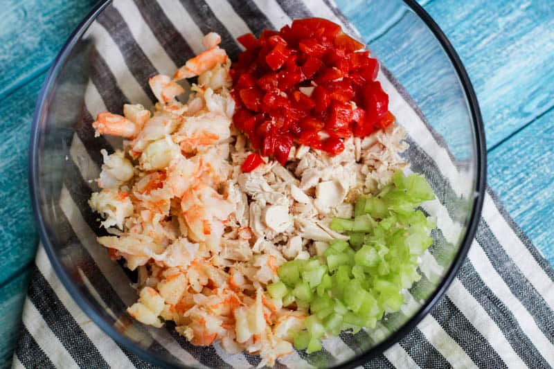 shrimp and chicken mix in glass bowl