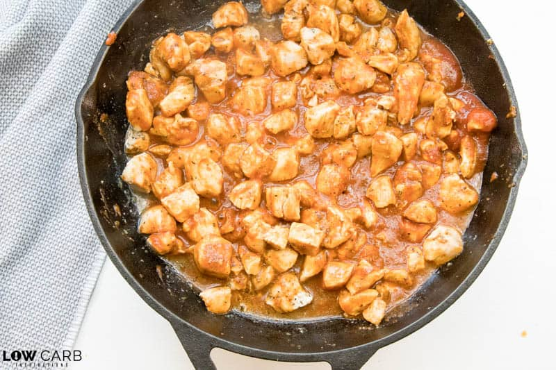chicken and sauce in a skillet stirred together
