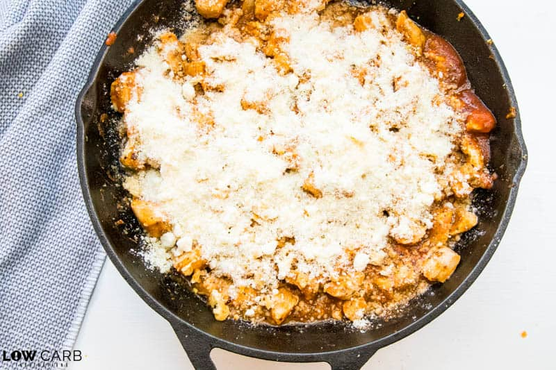 add cheese to the top of the keto chicken parmesan casserole
