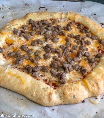 Deep Dish Cheese Stuffed Crust Keto Pizza Recipe made with cheese sticks!