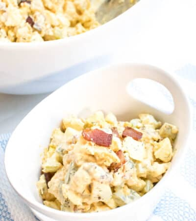 Impress your friends and family at the next gathering with this Keto Cauliflower Potato Salad Recipe! This is seriously delicious and everyone will gobble it up!