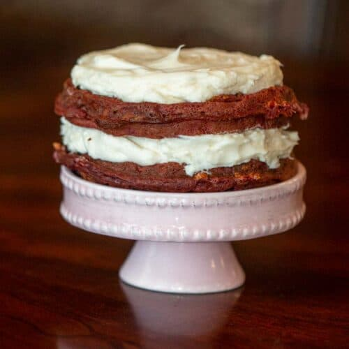 Keto Red Velvet Waffle Cake served on a mini cake plate.