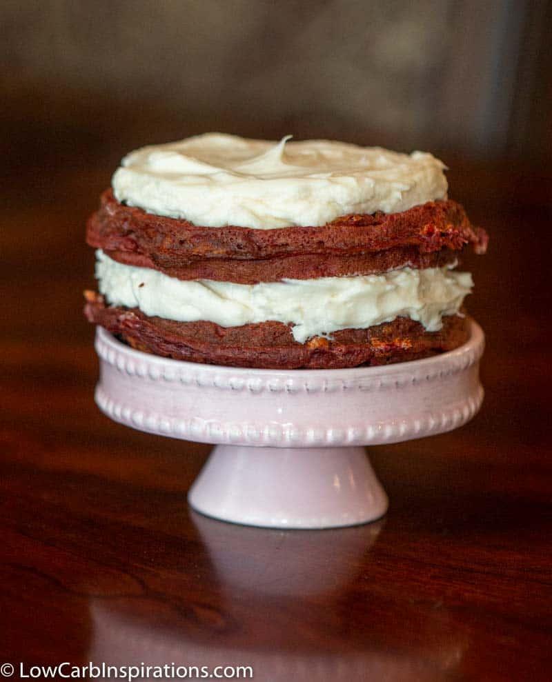 Keto Red Velvet Waffle Cake served on a mini cake plate.
