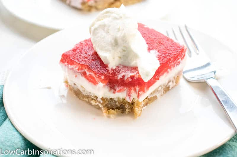 Keto Strawberry Pretzel Salad is a perfect dessert for any potluck! This keto friendly dessert uses pecans in place of pretzels to create a low-carb recipe you will love!