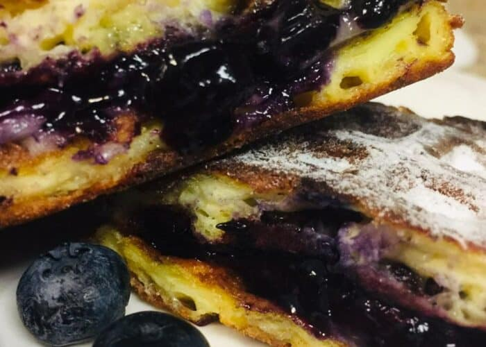 Blueberry and Brie...yes please! This fun twist on this Blueberry and Brie Grilled Cheese Chaffle recipe will have you wanting more!