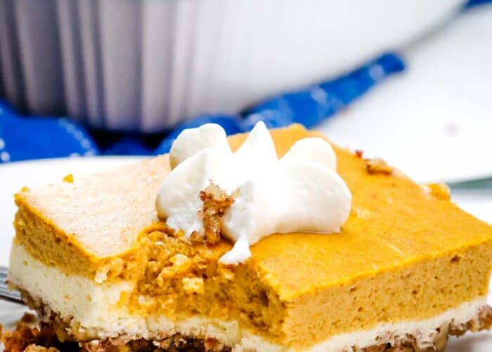 If you love pumpkin pie and cheesecake, you are going to love these Keto Pumpkin Cheesecake Bars! It's going to become your favorite keto fall dessert!