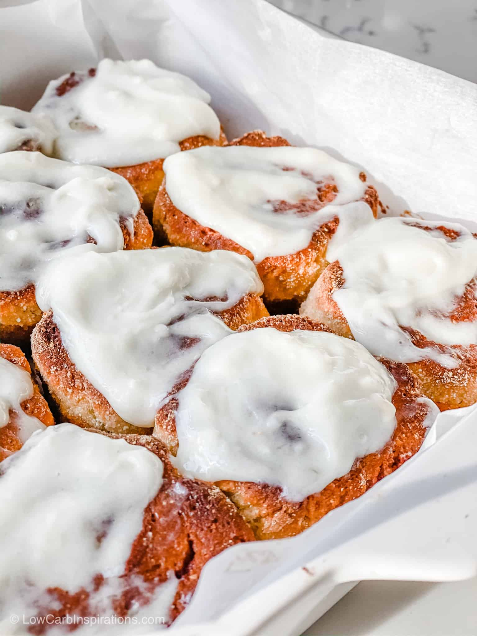 Close up of Keto Cinnamon Rolls with cream cheese frosting
