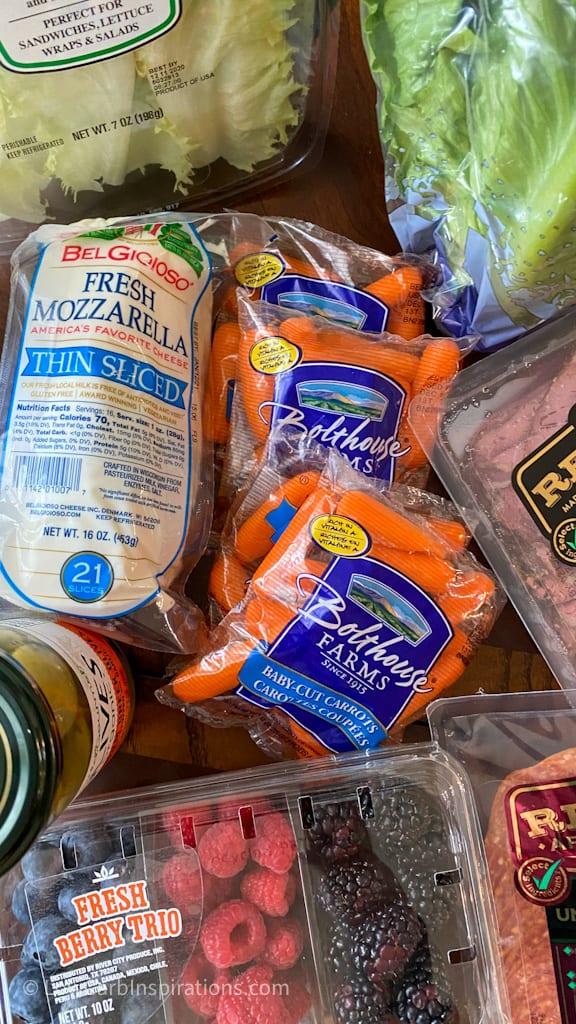 Carrots and sliced mozzarella cheese used in the Easy Keto Charcuterie Board with keto cornucopia bread