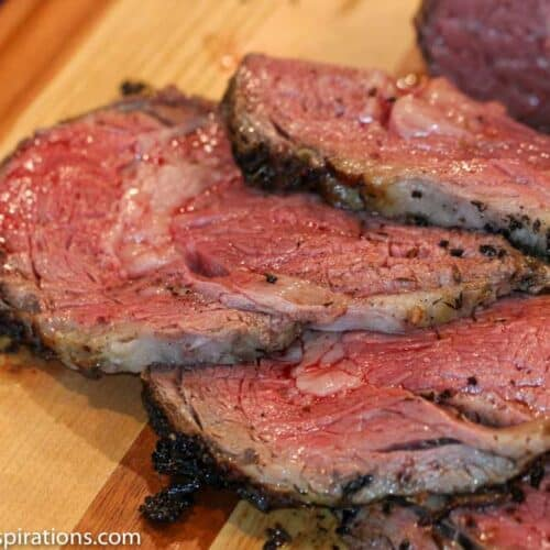 Best Prime Rib Recipe for the Holidays sliced on a cutting board