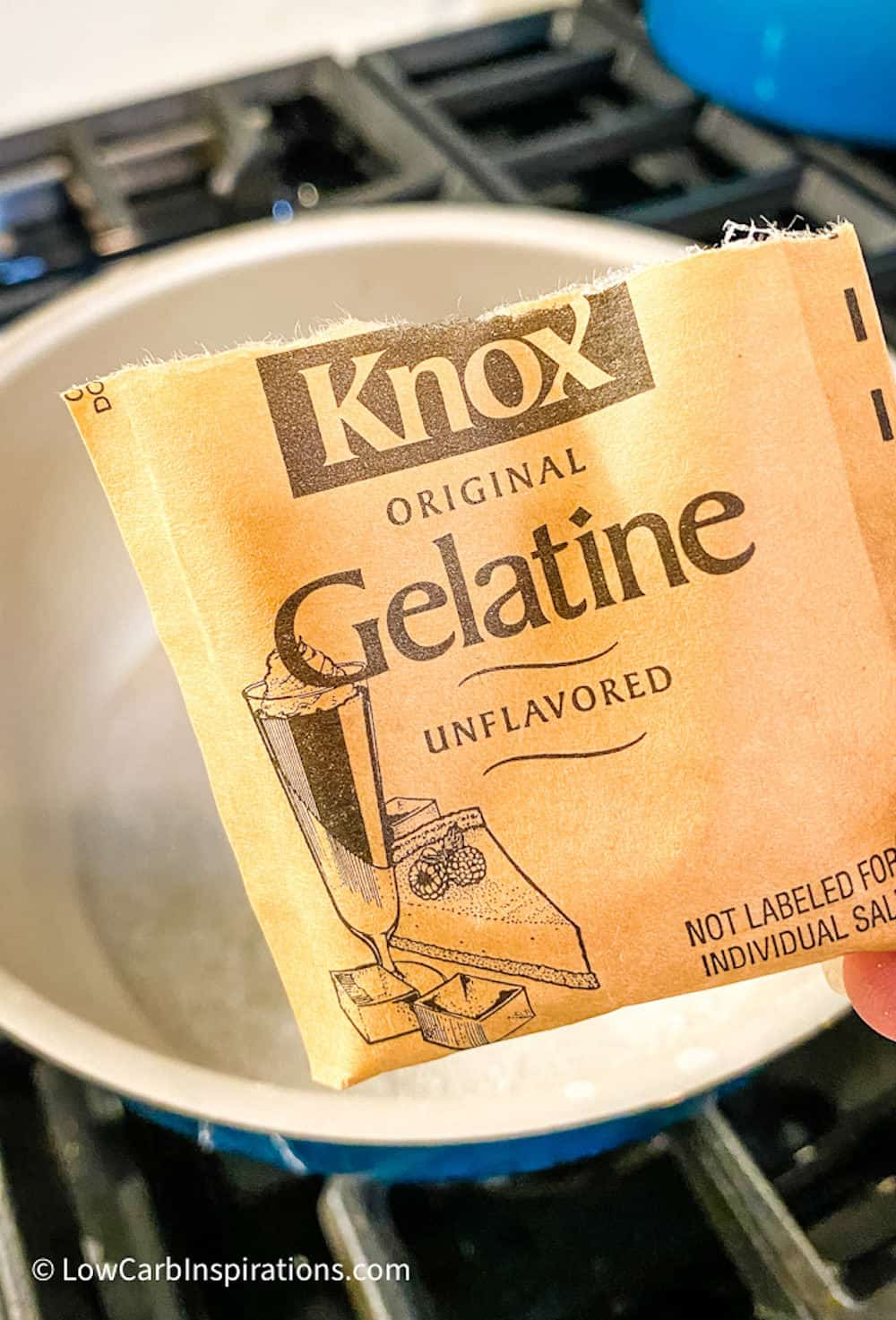 Knox gelatin packet with a sauce pan in the back of the photo