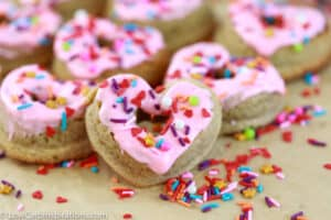 keto heart shaped glazed donuts with sprinkles on a table