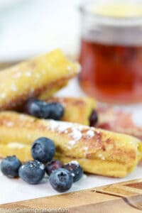 low carb blueberry breakfast roll ups with cooked bacon and blueberries