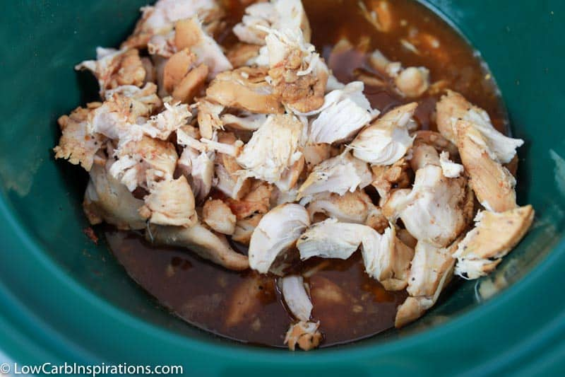 cooked keto chicken in bourbon sauce in the crockpot