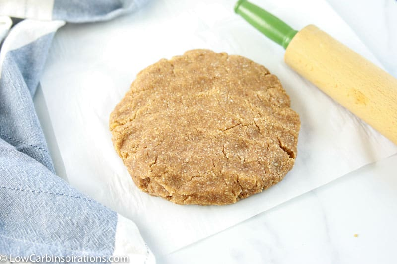 Keto Cinnamon Scones Recipe on parchment paper with a rolling pin