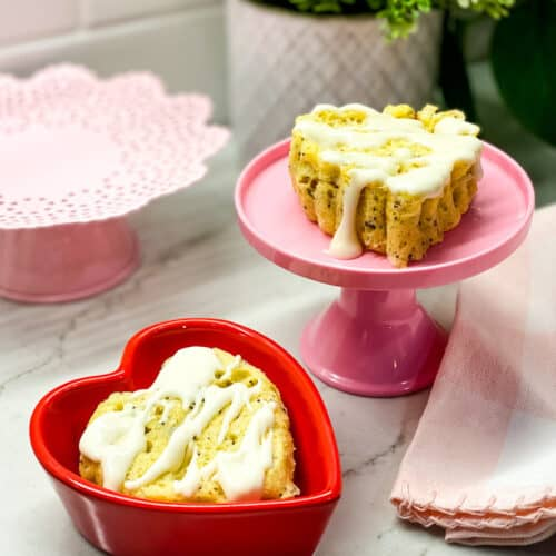 Two mini cakes on cake stands