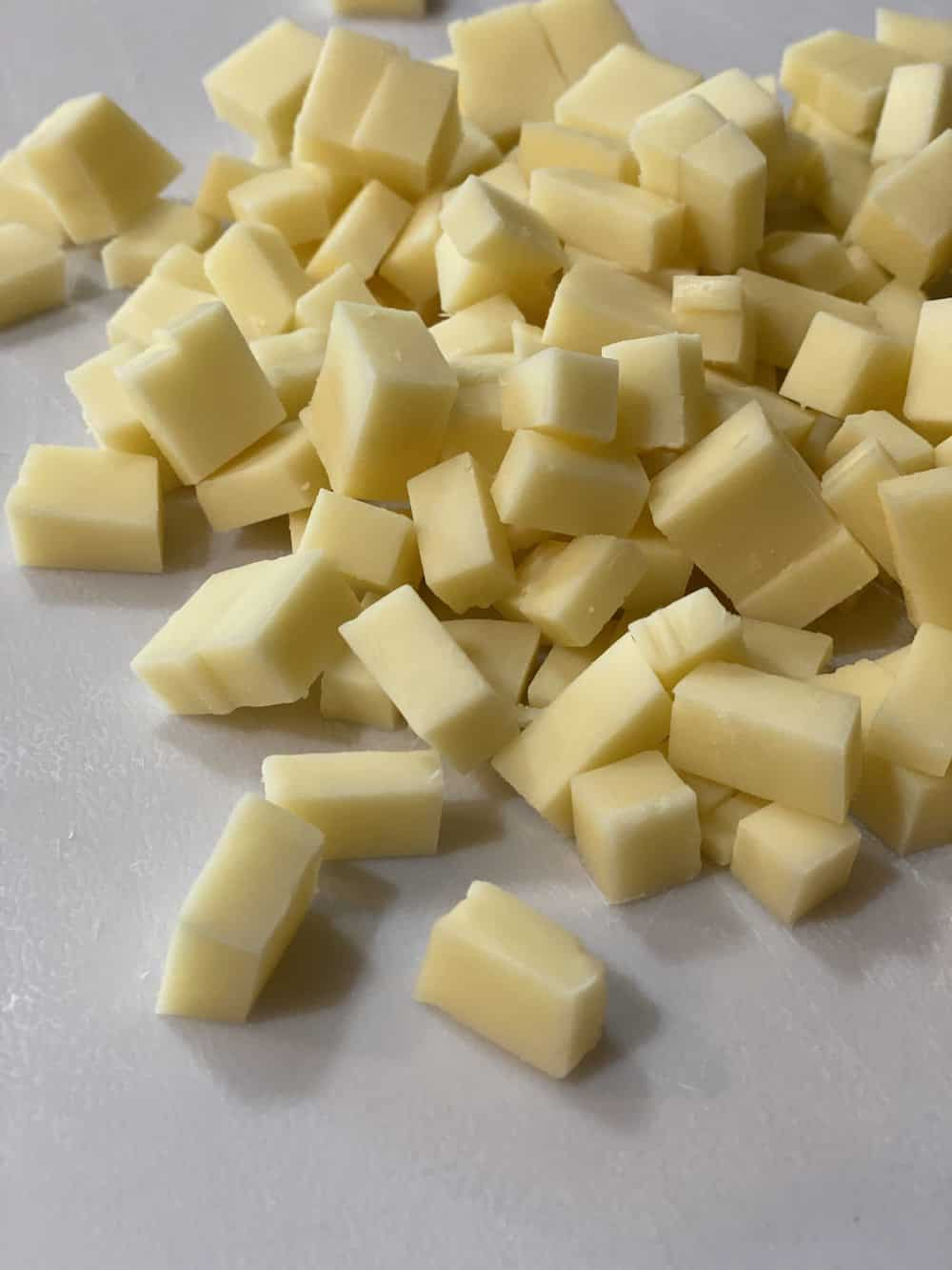 Cubes of white cheddar cheese