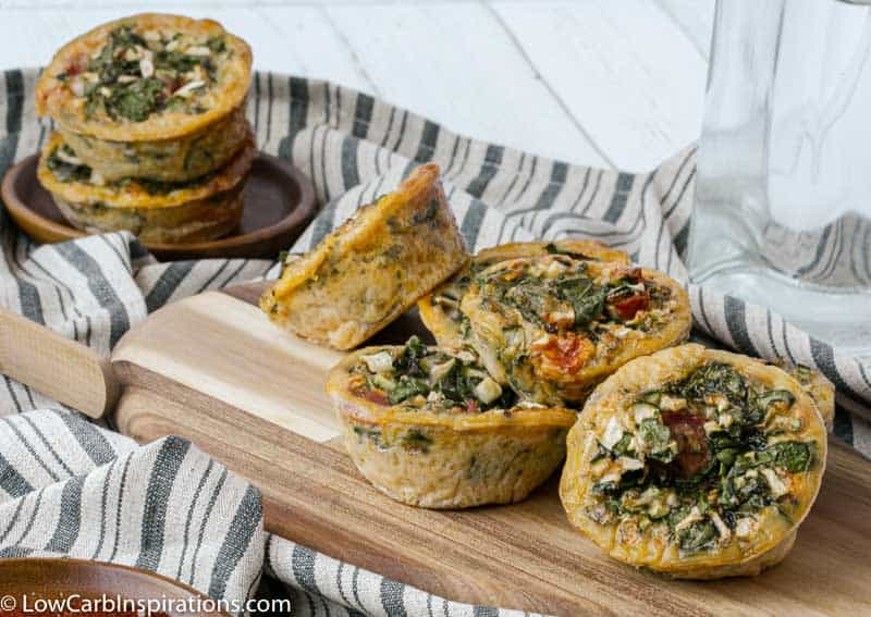 stacked egg muffins on a wood cutting board