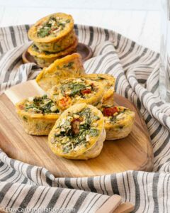 close up of stacked egg muffins on a wood cutting board