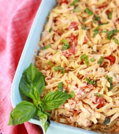low carb feta pasta in a casserole dish with fresh basil on top and on the side