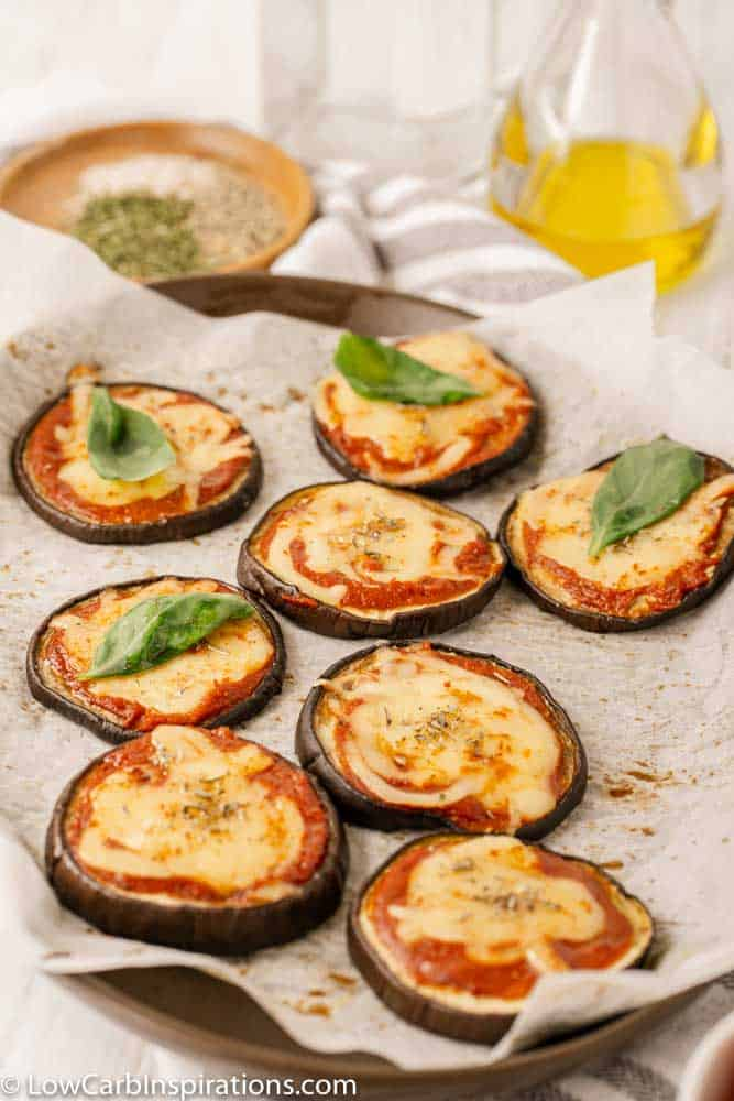 Mini Eggplant Margherita Pizza Recipe on a baking sheet with parchment paper