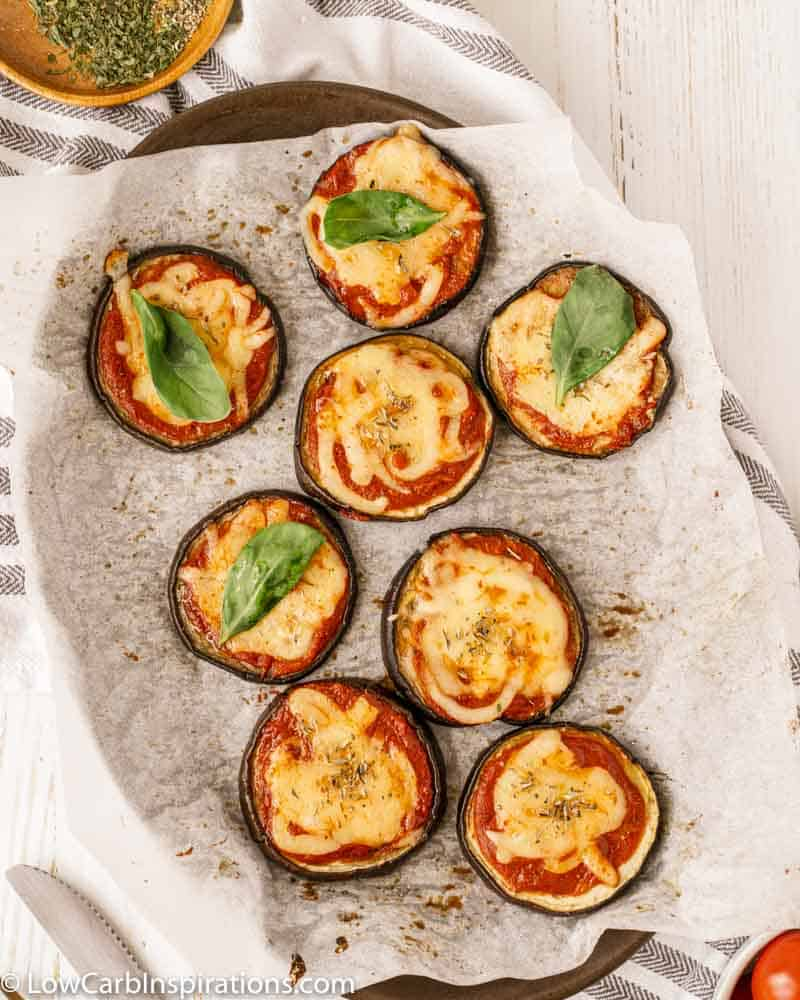 overhead photo of Mini Eggplant Margherita Pizza Recipe on a baking sheet with parchment paper