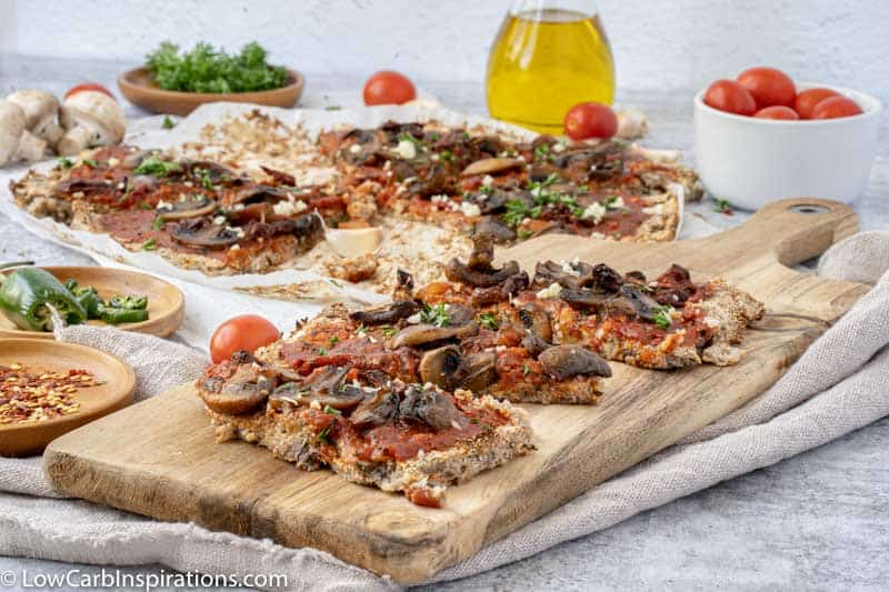 Mushroom Pizza Recipe with Cauliflower Crust on a wood serving board