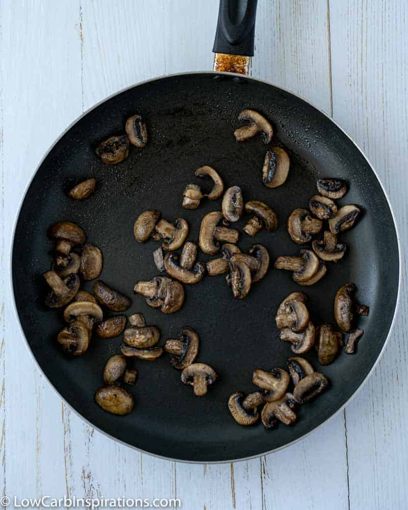 cooked and sliced mushrooms in a skillet