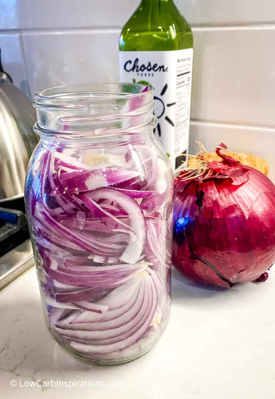 Cut red onions in a jar