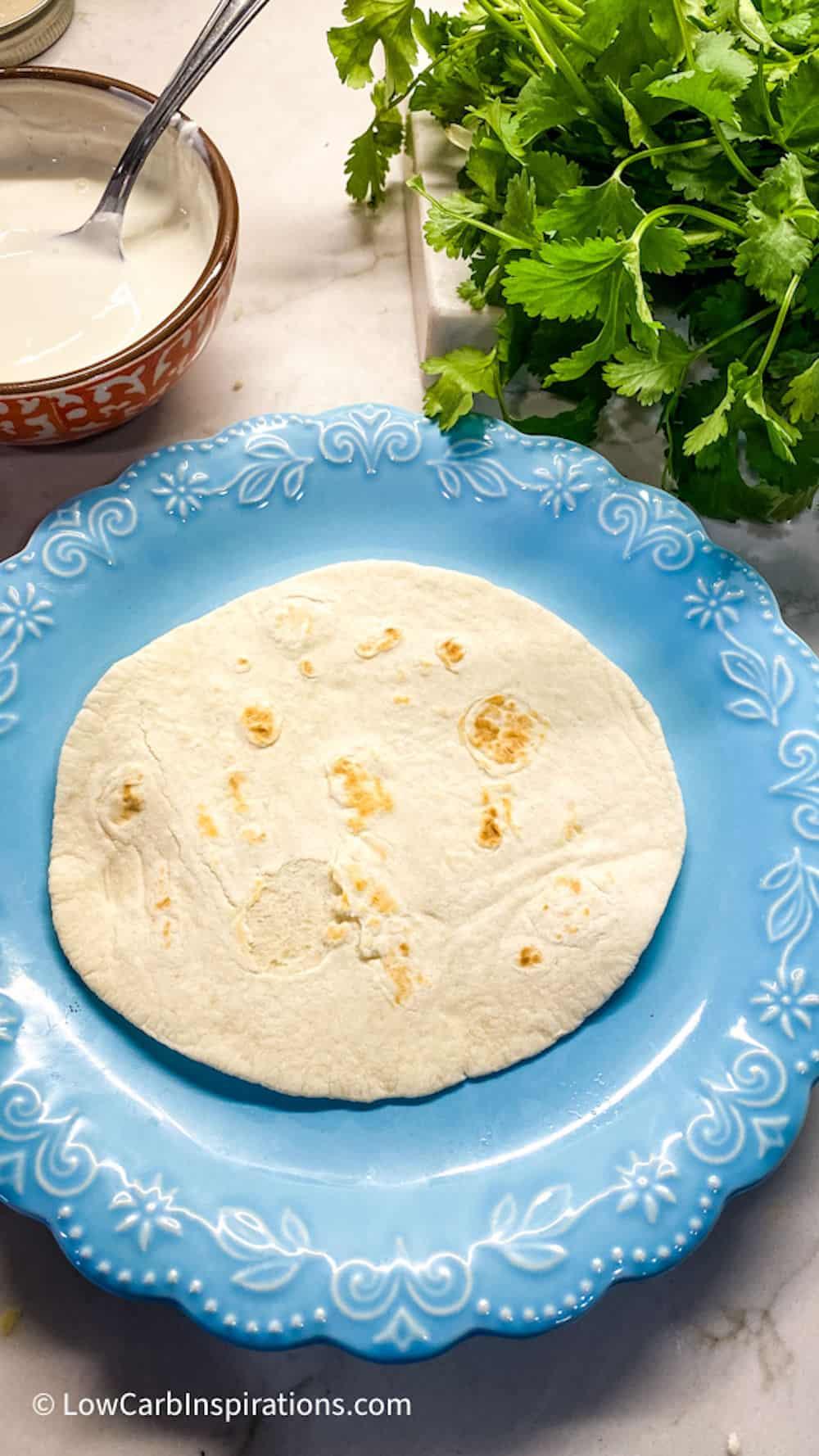 Tortilla on a blue plate