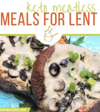 stuffed portobello mushrooms on a teal plate with olives, cheese and garnishment