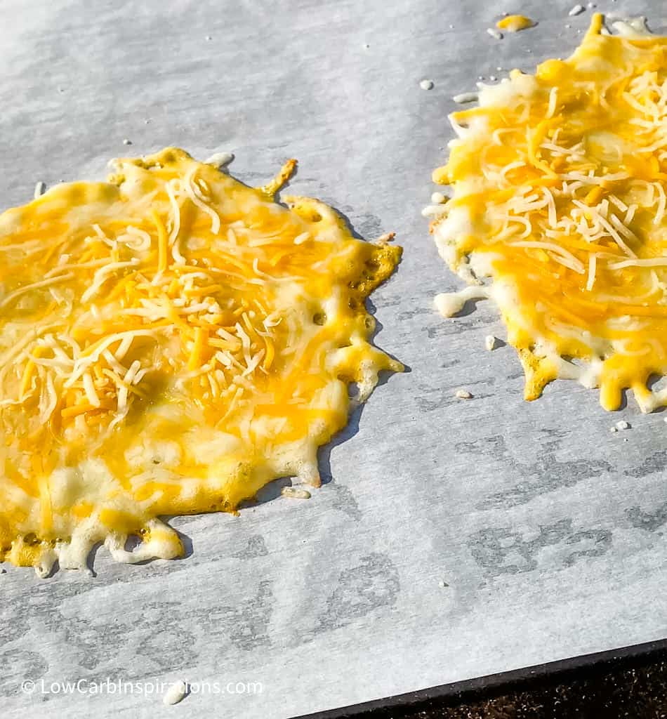 Cheese Taco Shells Recipe Ingredients Slices of your favorite cheese or shredded cheese Parchment paper for a non stick surface Equipment Needed Griddle or Frying Pan Cheese Taco Shells Recipe Instructions Preheat the griddle or frying pan over medium heat. Lay a slice of cheese or shredded cheese in a circle form layer with enough cheese not to see the bottom of the parchment paper.   Bake until the bottom forms a nice golden crust and the cheese has fully melted and is bubbling. To flip the cheese or not:  You can flip the cheese to cook the other side.  Just be sure you have enough room on the parchment paper to flip the cheese shell.  It's not require to flip the cheese for this technique to work. Soft cheese shell:  Only cook the cheese long enough for it to be fully melted and bubbly without changing color then pull from the heat. Crispy cheese shell:  Cook on both sides and allow the cheese to be fully melted and bubbling and then wait for the cheese to show a golden brown color.   Remove the shell from the heat and allow it to cool to a warm temperature before using the cheese taco shell.  You can even grab the corners of the parchment paper and place the hot cheese shell into a taco holder so that it cools in the taco shape! You can store them for later use by placing a piece of parchment paper between each cheese taco shell and placing it in the refrigerator until you are ready to use it.  It will keep for at least 5 days in the refrigerator.  I have not tried freezing them yet.   No need to buy Folios Cheese Wraps anymore because this is how you make your own!  We learned this when we microwaved cheese slices as seen in this recipe:  Homemade Cheese Wraps Recipe