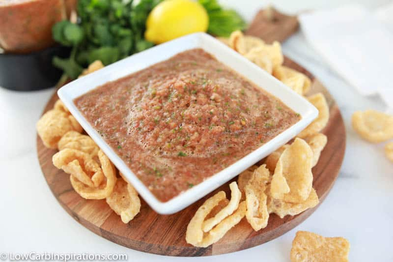 easy blender salsa recipe in a square white bowl with chips on the side of a plate