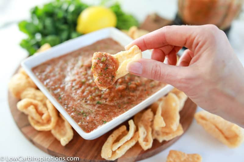 finished blender salsa recipe in a white square bowl with a scoop of homemade salsa