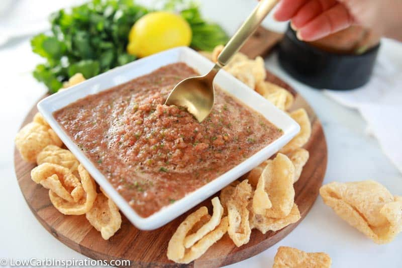 finished blender salsa recipe in a white square bowl with a gold spoon