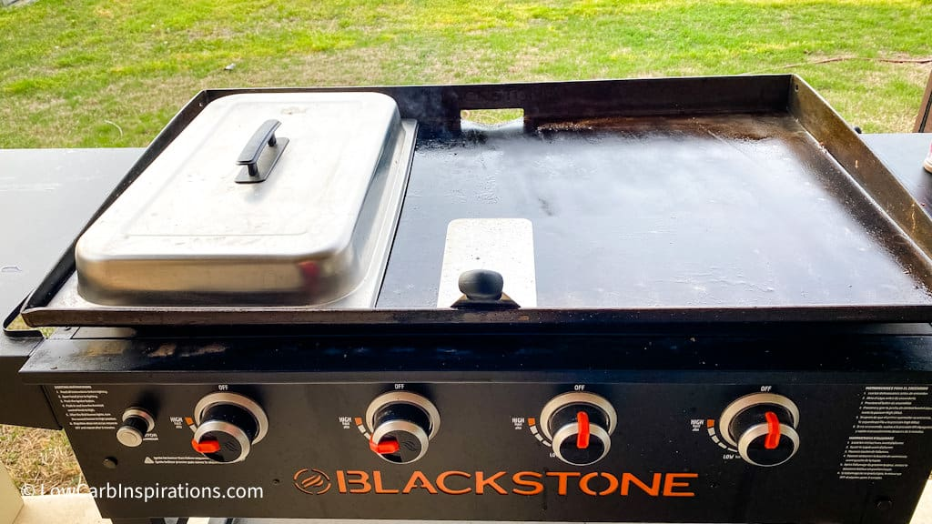 Blackstone griddle grill, cooking cover, and a spatuala