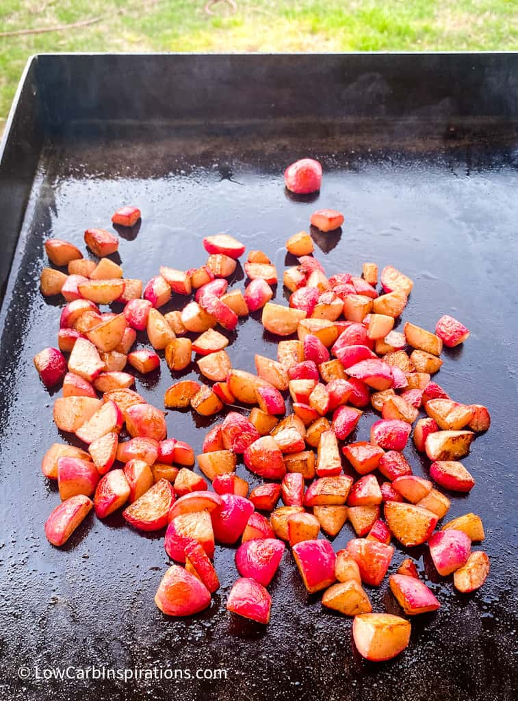 Radishes cooking on the griddle grill