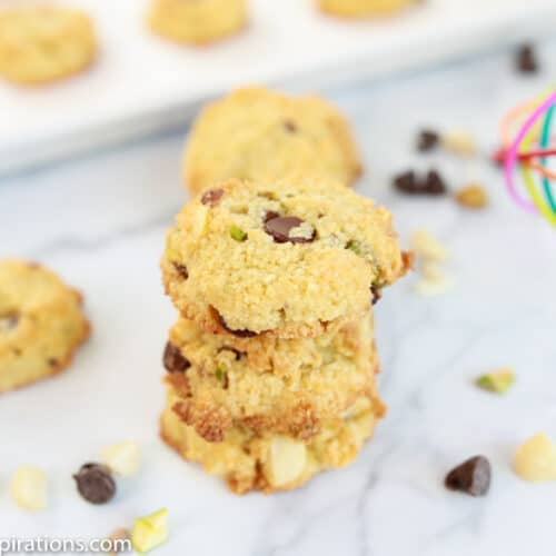 close up of keto cookie recipe with cookies and a whisk in the background
