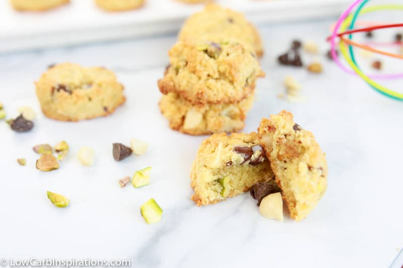 close up of homemade cookie recipe on a table with cookies and a whisk in the background