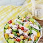 close up of keto dressing recipe on a salad with ranch salad dressing on the side