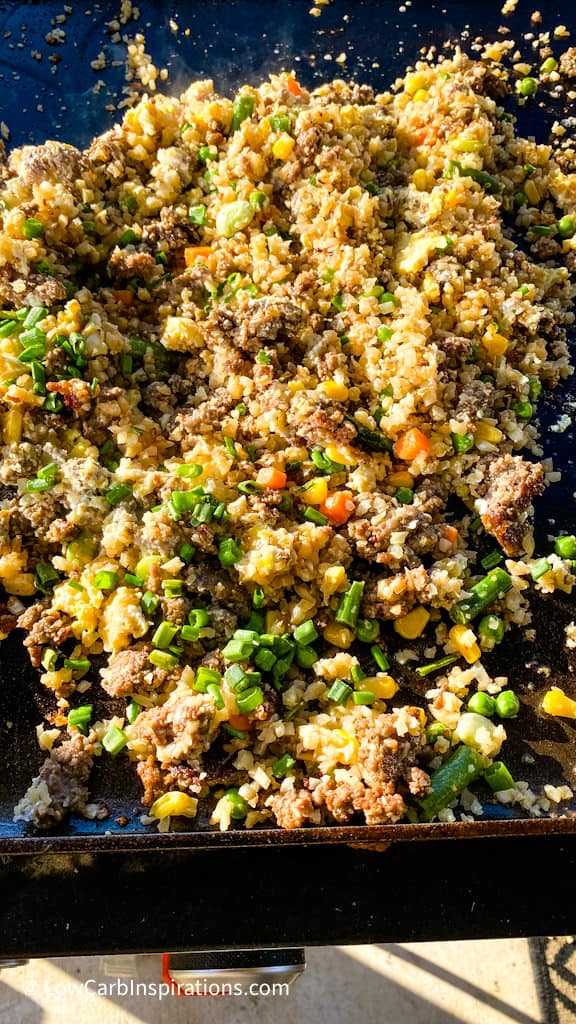 Close up of fried rice on a Black Stone Griddle Grill while it's cooking
