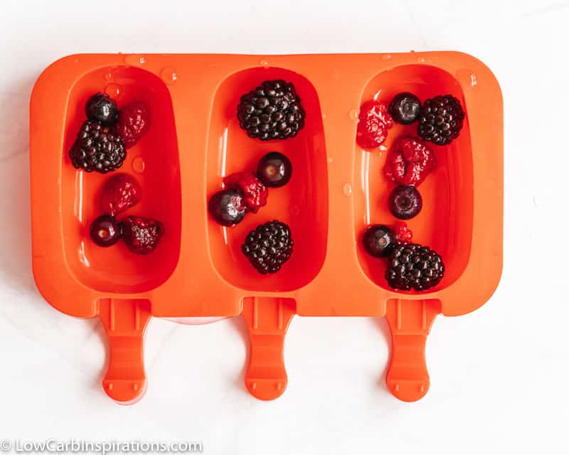 mixed berries in a popsicle mold