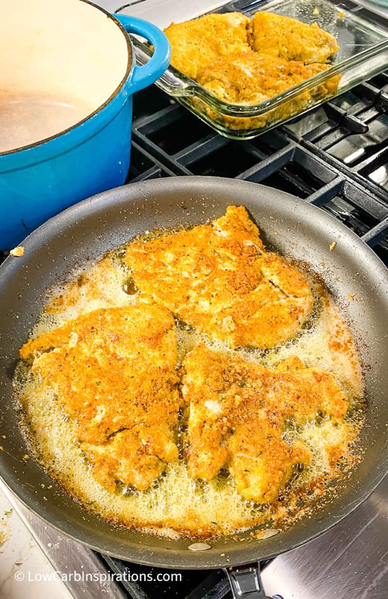 Partially cooked chicken in a frying pan
